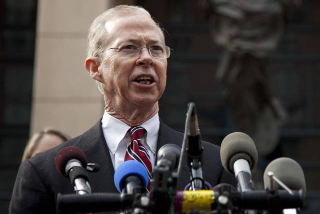 FILE - In this Jan. 26, 2012, file photo Dana Boente speaks outside federal court in Alexandria, Va. On Friday, May 25, 2018, The Associated Press has found that stories circulating on the internet that Boente announced he's investigating former President Barack Obama for treason are untrue. (AP Photo/Evan Vucci, File)
