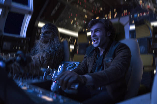 "In this image released by Lucasfilm, Alden Ehrenreich, right, and Joonas Suotamo appear in a scene from ""Solo: A Star Wars Story."" (Jonathan Olley/Lucasfilm via AP)"