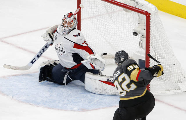 Washington Capitals goaltender Braden Holtby, left, is scored on by Vegas Golden Knights left wing Tomas Nosek, of the Czech Republic, during the third period in Game 1 of the NHL hockey Stanley Cup Finals Monday in Las Vegas.