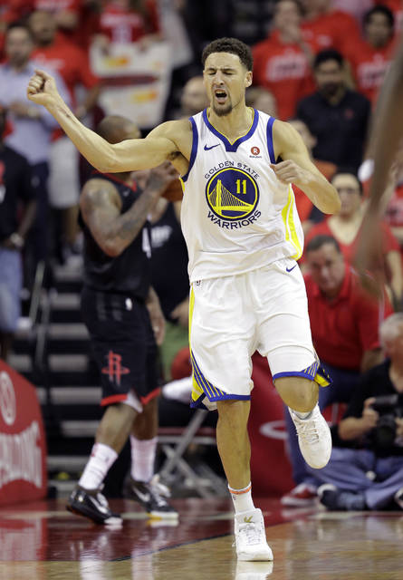 Golden State Warriors guard Klay Thompson (11) celebrates after scoring against the Houston Rockets during the second half in Game 7 of the NBA basketball Western Conference finals, Monday.