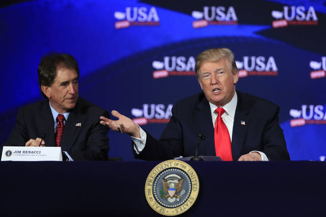 President Donald Trump with Rep. Jim Renacci, R-Ohio, left, speaks during a roundtable discussion on tax reform at Cleveland Public Auditorium and Conference Center in Cleveland, Ohio, Saturday, May 5, 2018. (AP Photo/Manuel Balce Ceneta)