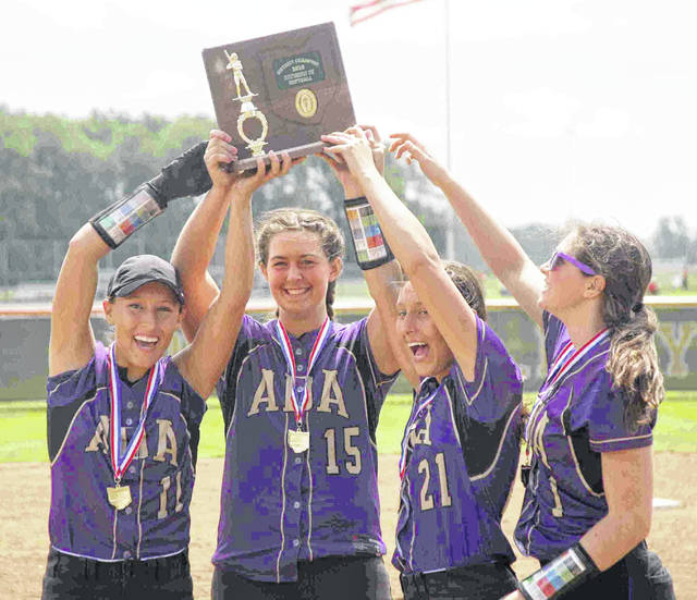Ada captains (l-r) Katie Newland, Maddie Gossard, Sydney Newland and Olivia Alexander, hoist the Division IV District championship trophy at Elida Saturday.