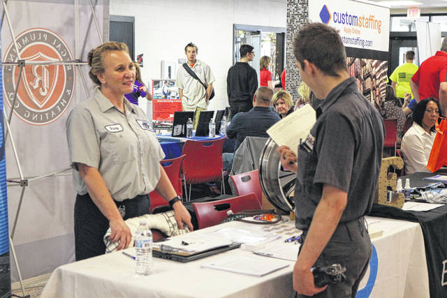 Stacey Pickens (left) with AAP St. Marys talks with Apollo student Keithan Furr (right) about possible career opportunities.