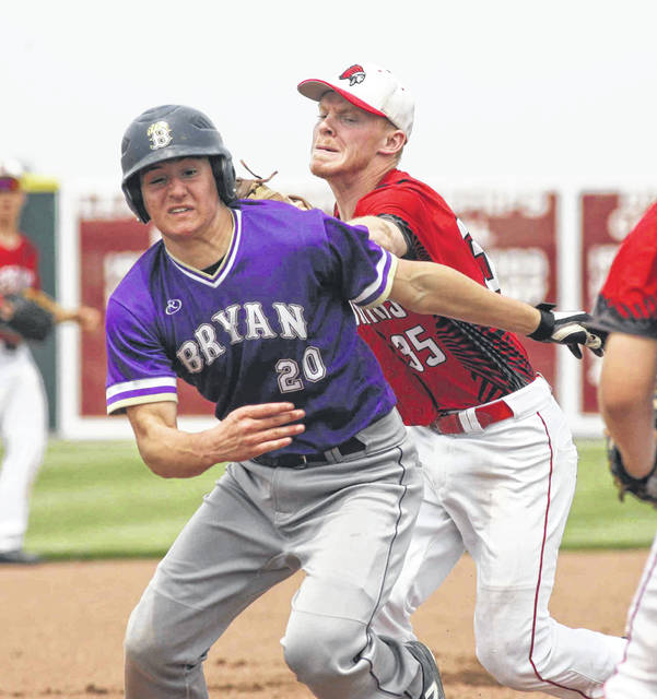 Bryan's Nate Miller is tagged out by Wapakoneta's Gage Schenk in a rundown in the first inning of the Division II district semifinals Thursday at Patrick Henry High School.