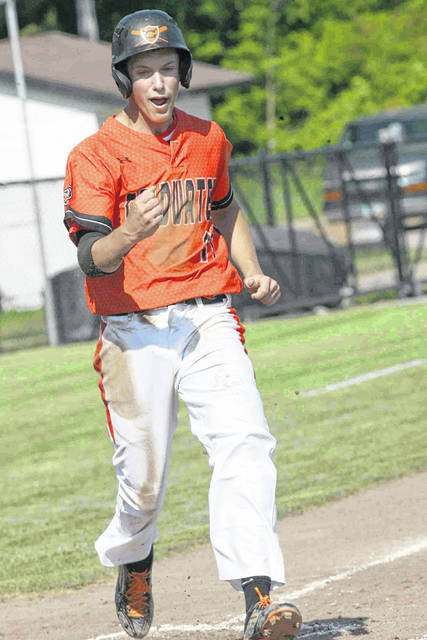 Sam Broering gives a little fist pump after scoring Coldwater's first run against Columbus Academy in Friday night's Division III regional final at Elida.