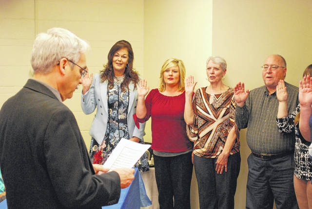 J Swygart | The Lima News  Lima Municipal Court Judge Glenn Derryberry issued oaths to 16 new court-appointed children's advocates Tuesday during a ceremony at the CASA offices in downtown Lima. The new advocates recently completed 35 hours of required training and will assist children who for no reason of their own are entangled in the legal system locally.