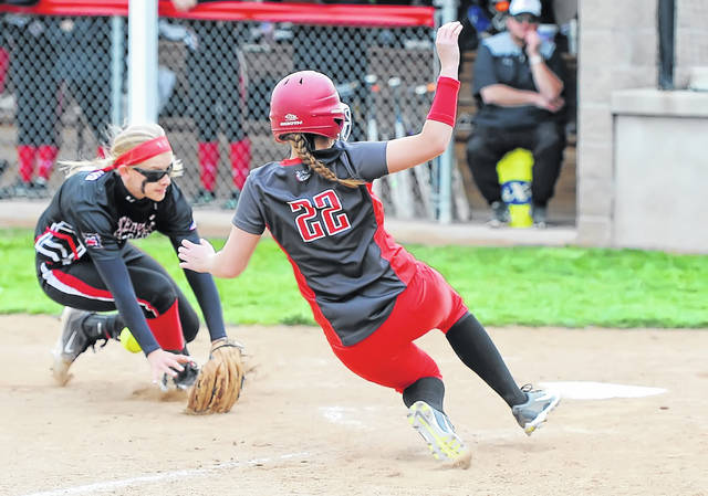 Columbus Grove's Angel Schneider reaches home before Spencerville's Julie Mulholland can apply the tag during Friday night's game in Columbus Grove.