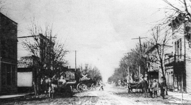 This photo shows the businesses in the 100 block of East Main Street looking west toward the railroad crossing. Everything shown was destroyed by fire May 2, 1918.