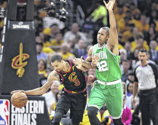 George Hill (3) of the Cleveland Cavaliers controls the ball as the Boston Celtics' Al Horford (42) defends him early in the Cavaliers 116-86 win over the Celtics on Saturday night in Cleveland.
