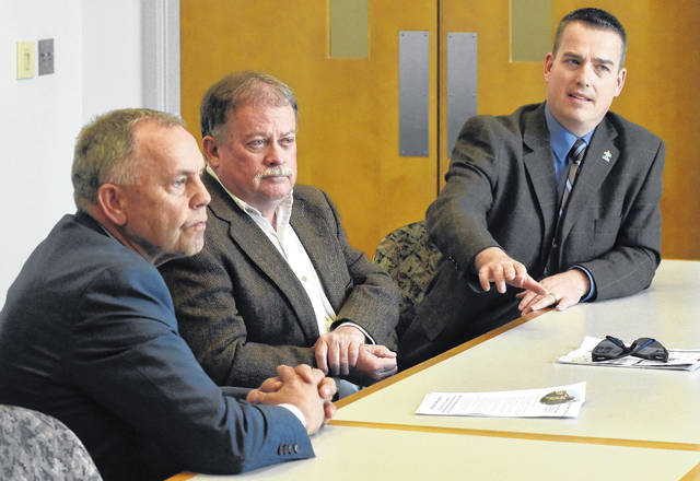 Allen County Commissioners, Jay Begg, left, Greg Sneary, and Cory Noonan, discuss the sales tax levy during a meeting with The Lima News editorial board.