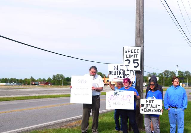 A group from Allen & Hardin for Election Action and Democracy held a rally to call for support for net neutrality Monday in front of U.S. Rep. Jim Jordan's Lima office.