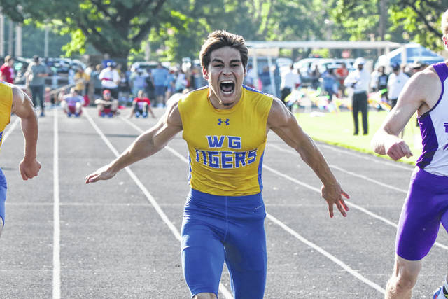 Waynesfield-Goshen's Tyler Eller celebrates crossing the finish line first in the 100 meter dash Friday night at the Division III Regional at Troy High School.   Levi A. Morman | The Lima News