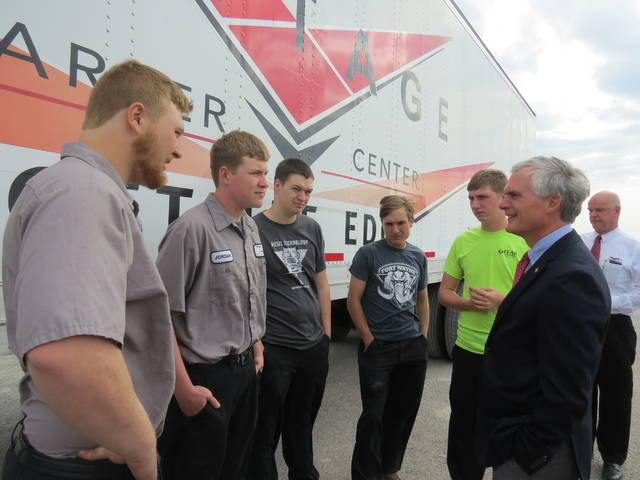 Congressman Bob Latta talks to five Vantage seniors who are participating in the innovative new high school CDL truck driving program during his visit to Van Wert County.