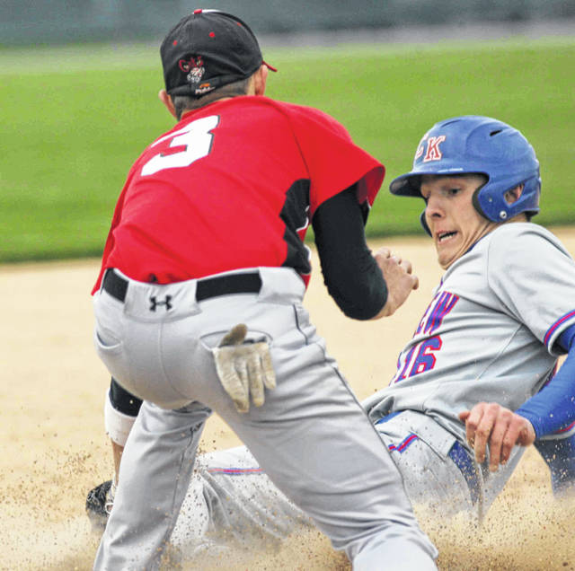 Crestview's Brandt Richardson slides safely into third base under the tag of Jefferson's Hunter Haehn on a fielder's choice play at Delphos Jefferson on Friday night.