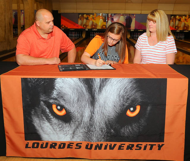 Bath's Bryana Twining signs her letter of intent with parents Dave and Jodie Twining on Wednesday at 20th Century Lanes.  Richard Parrish photo