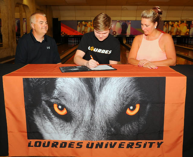 Shawnee's Skyler Briggs signs his letter of intent with parents Clint and Shauna Briggs on Wednesday at 20th Century Lanes.  Richard Parrish photo
