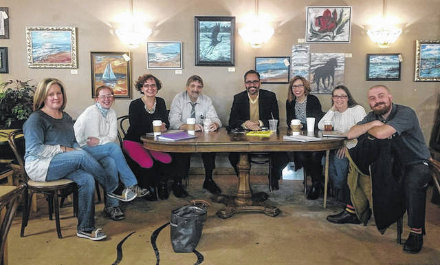 From left: Jennifer Blankemeyer, Tiffany Cutshall, Aimee Bucher, Perry S. Luhn, Fred Arzola, Jodi McDermitt, Cris Elstro and Cody R. Tucker at a Lima Writers' Community group meeting.