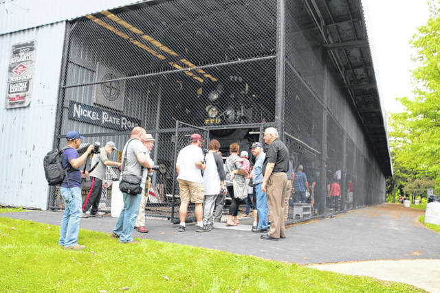 Railroad enthusiasts travelled from Springfield, Ohio to Lima by raiil to view the Shay Locomotive display at Lincoln Park.