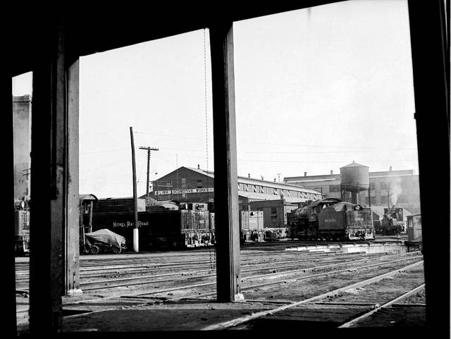 Railroad photographer Richard Cook took this photo looking toward the Lima Locomotive Works from inside the Nickel Plate round house in August 1947 during the waning days of the steam locomotive. Although the Nickel Plate would not run its last steam train through Lima for another decade, the Loco rolled out its last steam locomotive in 1949.