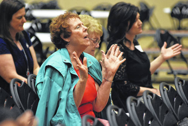 Martha Richardson, of Lima, participates in the National Day of Prayer event held at the UNOH Event Center on Thursday.
