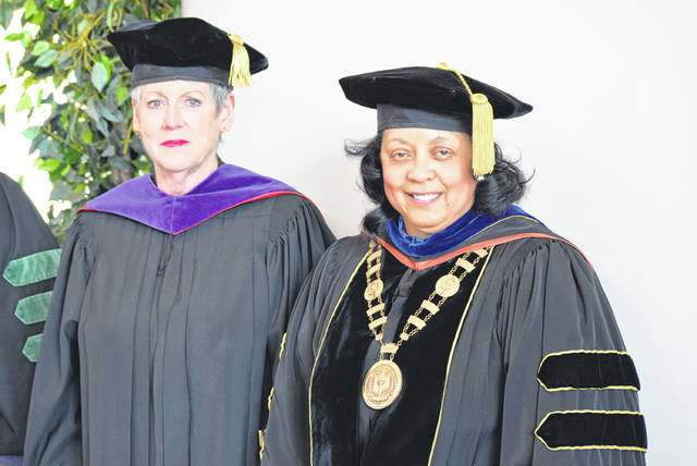 Ohio Supreme Court Chief Justice Maureen O'Connor (left) stands next to Rhodes State College President Dr. Debra McCurdy at Saturday's graduation ceremonies at the Civic Center in Lima.