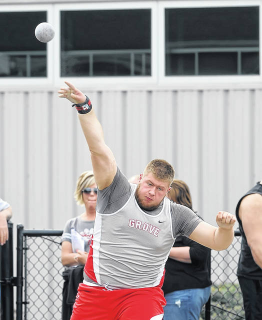 Columbus Grove's Cody Jackson competes in the shot put during Friday night's Putnam County League Meet in Columbus Grove.  Richard Parrish | The Lima News