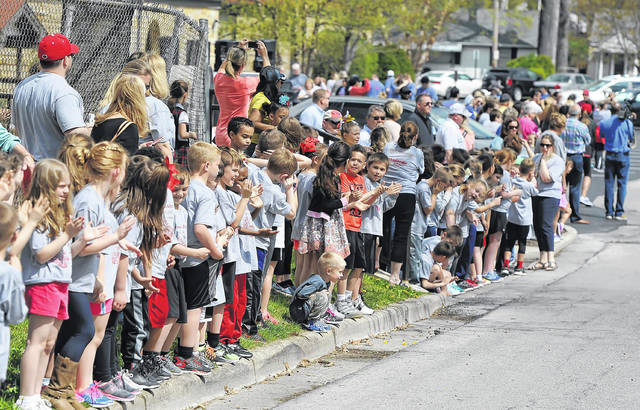 Runners are cheered on at the Positive Addiction Run/Walk on Friday.