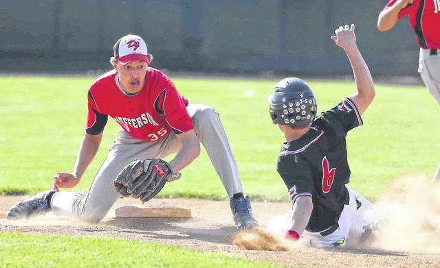 Jefferson's Tyler Bratton (35) prepares to put the tag on Spencerville's Drake Mertz for the out at second base at Spencerville High School Monday.