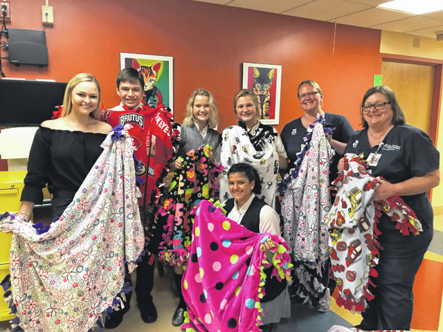 "As part of the ""Blessed, Not Stressed"" event, blankets were presented to Mercy Health-St. Rita's Medical Center staff. Those attending the presentation of the blankets were: Olivia Miller, Gage Steman, Cassidy Schafer, Reagan Clarkson, Jill Gemmer, Sally Recker, RN and Kellie Rider, RN."
