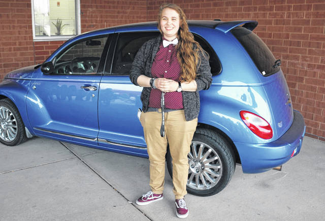 Elizabeth Walter stands in front of a PT Cruiser she won in a referse raffle as part of the Honors Banquet at Lima Senior High School.