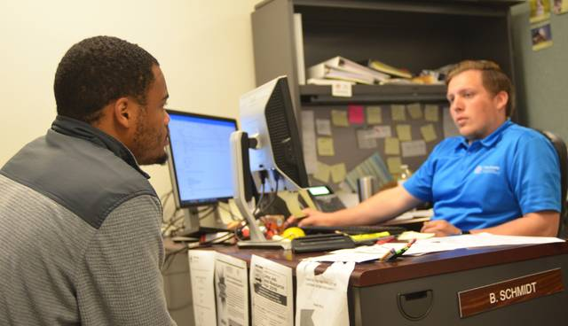 Lima Senior student Jimmy Perryman discusses his career choices with Job Coach Brock Schmidt at the Allen County office of OhioMeansJobs.