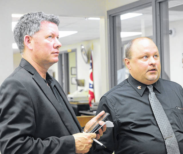 Elida's Treasurer Joel Parker, left, and Superintendent Joel Mengerink react after the Elida Local Schools Bond Issue, 2.8 Mills Tax Levy & .5 Mill Tax Levy passed on Tuesday night at the Allen County Board of Elections.  Richard Parrish | The Lima News