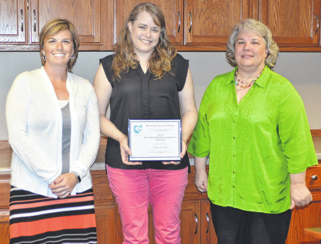 Kayla Monfort, Activate Allen County Coordinator, and Lori Nester, of Allen County WIC, present Jennifer Brogee from the Meeting Place on Market with the Ohio Lactation Consultant Association Most Breastfeeding Supportive Business Award during the Lima/Allen County Chamber of Commerce meeting recently.