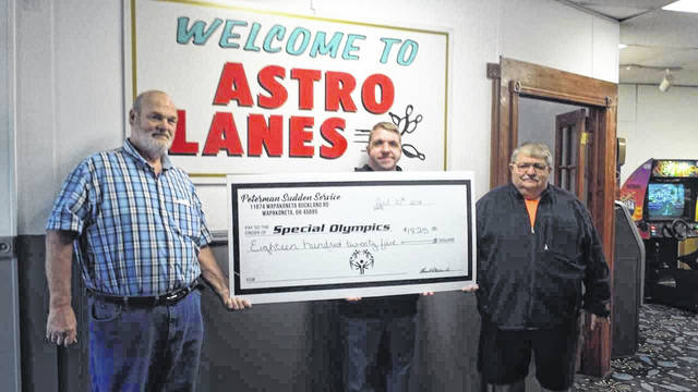 Pictured (left to right): Tom Peterman, Sr., owner of Peterman Sudden Service, LTD.; Mike Moore (Top Seller and 11-300 games to his credit); and Gary Moore. David Axe, president of the Auglaize County Special Olympics, is not pictures.