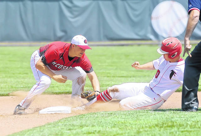 Wapakoneta's Manny Vorhees tags out Oberlin Firelands' Colin Ransom during a Thursday Division II regional semifinal at Carter Park in Bowling Green.