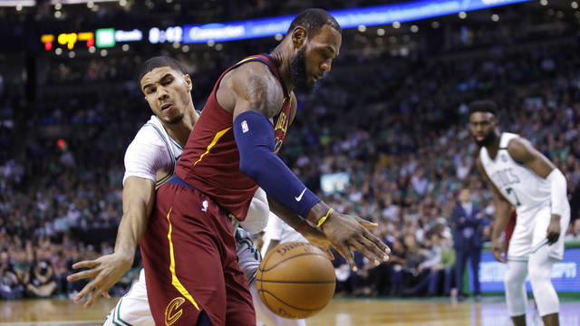 Cleveland Cavalier's LeBron James loses the ball as he is pressured by Boston Celtics Jayson Tatum during Game 2 of the Eastern Conference basketball finals in Boston, Tuesday, May 15, 2018. (AP Photo/Charles Krupa)