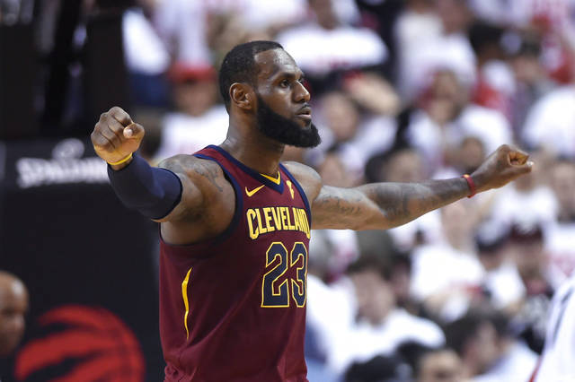 Cleveland Cavaliers forward LeBron James celebrates after the Cavaliers defeated the Toronto Raptors in Game 1 of an NBA basketball playoffs Eastern Conference semifinal Tuesday night in Toronto. (Nathan Denette/The Canadian Press via AP)