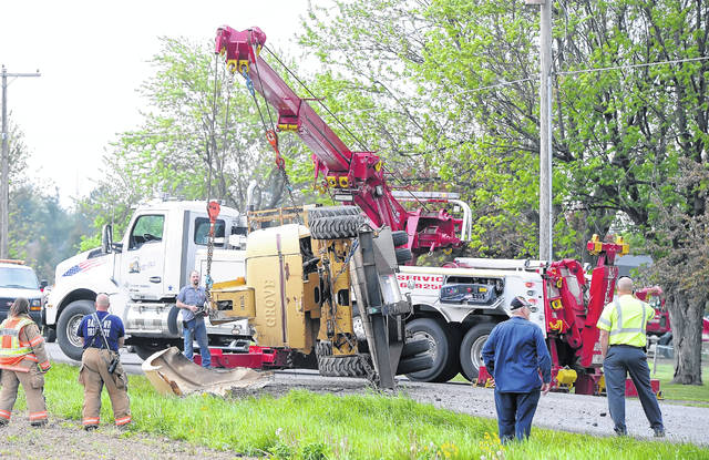 Bath Township Fire and Rescue respond to a crane over turned around 3000 North Thayer Road on Monday morning.