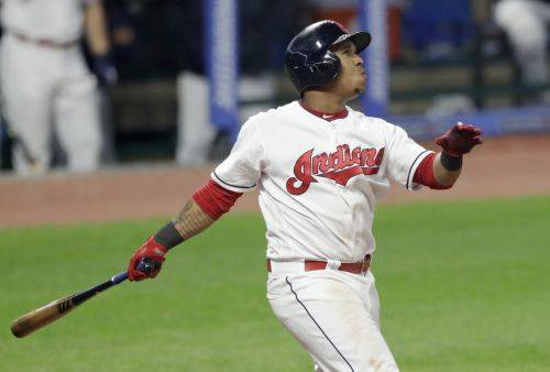 The Indians' Jose Ramirez watches his two-run home run in the fifth inning in the second game of a Thursday doubleheader against the Toronto Blue Jays in Cleveland. Jason Kipnis also scored on the play. (AP Photo/Tony Dejak)