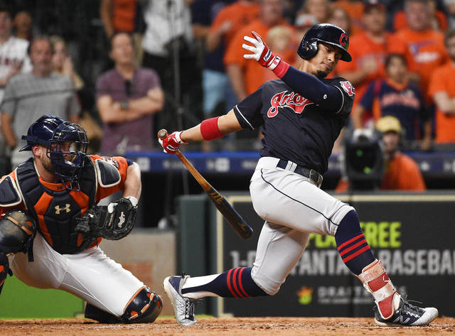 Cleveland Indians' Francisco Lindor strikes out to end the team's baseball game against the Houston Astros, Friday, May 18, 2018, in Houston. Houston won 4-1. (AP Photo/Eric Christian Smith)