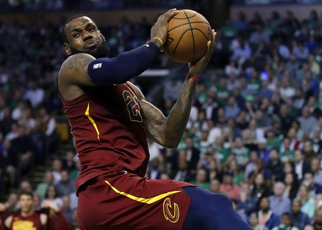 Cleveland Cavaliers forward LeBron James recoils after colliding with Boston Celtics forward Jayson Tatum during the first half in Game 2 of the NBA Eastern Conference finals on Tuesday in Boston. (AP Photo/Charles Krupa)
