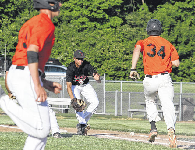 Fort Loramie's Jared Middendorf runs up on a short hit as Minster's August Boehnlein runs towards first and Minster's Jacob Niemeyer runs for home during a Division III regional semifinal on Thursday at Carleton Davidson Stadium in Springfield.