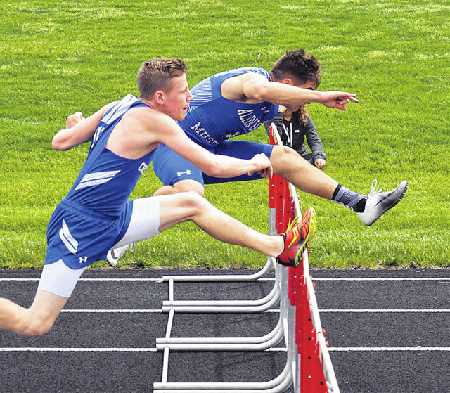 Allen East's Kyle Nickles, right, and Crestview's Tyler White compete in the 110 meter hurdles Saturday during the Northwest Conference Meet in Spencerville. Dean Brown | The Lima News