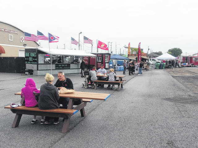 Five barbecue vendors were at this year's PigMania at the Allen County Fairgrounds. The event runs through 11 p.m. today. Admission is $5, $10 after 8 p.m.