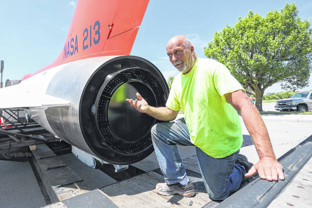Fabricator and painter Tom Casanova of Thomarios, explains the restorations and repairs made to the F5D-1 Skylancer on Wednesday afternoon.