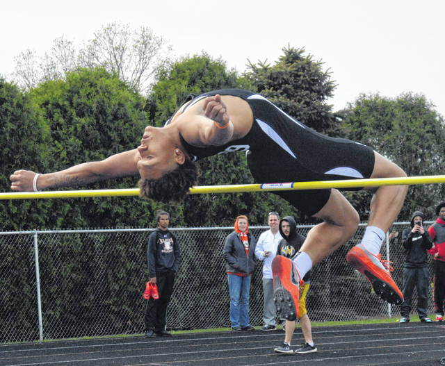 Elida's KeShawn Spivey clears the bar in the high jump during Friday night's Western Buckeye League Championships at Ottawa-Glandorf.