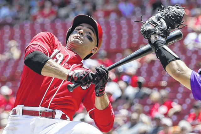 The Reds' Joey Votto dodges a pitch by Colorado's Tyler Anderson during Thursday's game in Cincinnati.