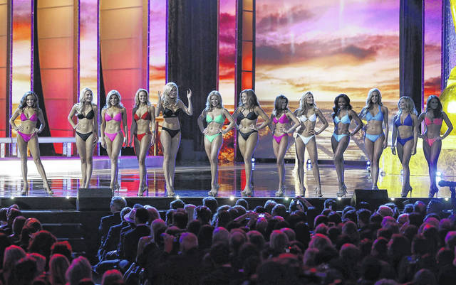 In this Sept. 13, 2015, photo, contestants wear swimsuits as they compete in the 2016 Miss America pageant in Atlantic City, N.J. The Miss America Organization is dropping the swimsuit competition from its nationally televised broadcast, saying it will no longer judge contestants on their appearance.