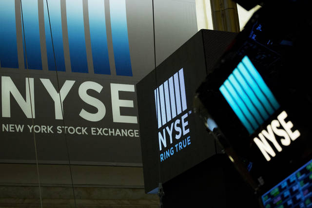FILE- In this May 10, 2018, file photo signs for the New York Stock Exchange hang above the trading floor. The U.S. stock market opens at 9:30 a.m. EDT on Wednesday, June 6. (AP Photo/Mark Lennihan, File)