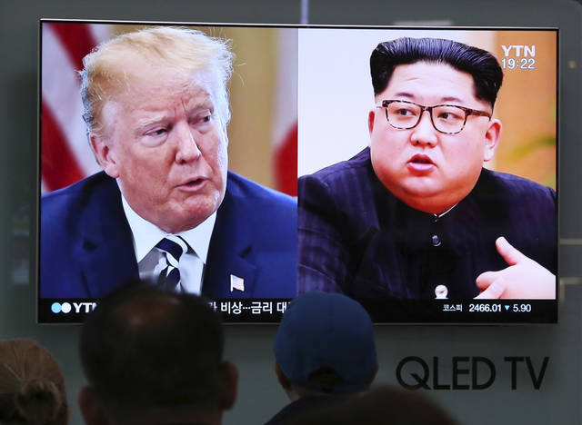 FILE - In this May 24, 2018, file photo, People watch a TV screen showing file footage of U.S. President Donald Trump, left, and North Korean leader Kim Jong Un during a news program at the Seoul Railway Station in Seoul, South Korea.  The self-proclaimed master dealmaker is facing doubts from multiple corners as he prepares to negotiate with Kim Jong Un. Ahead of President Donald Trump's landmark summit next week with the North Korean leader, U.S. allies and even many Republicans are raising concerns that he may impulsively give in on issues they say should be deal-breakers for the United States.  (AP Photo/Ahn Young-joon, File)